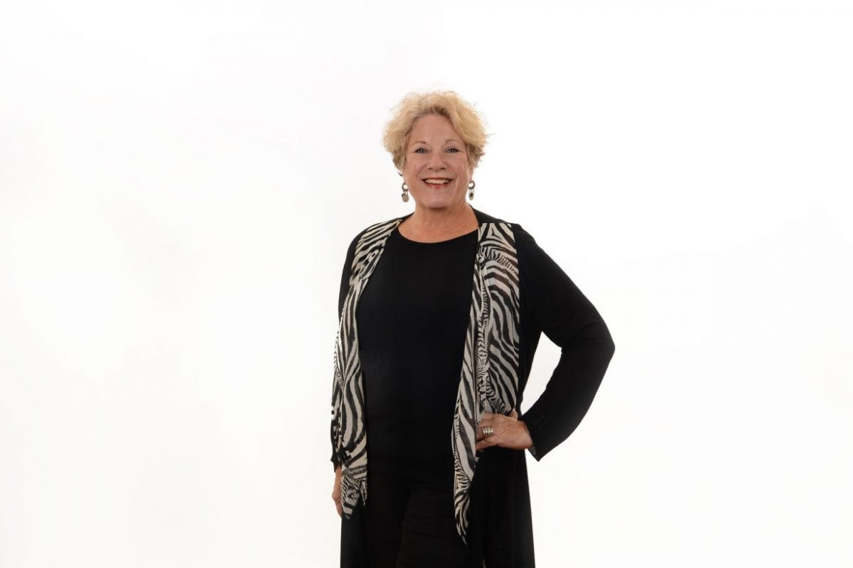 Vickie Case in black-outfit-w-scarf compressed for Homepageslider